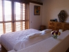 The master bedroom at The Penthouse at Casa Que Ve Al Mar