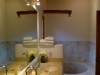 The master bath includes his & her vanity sinks as well as a sunken bathtub.
