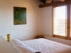 The front bedroom features a beautiful piece of art by local painter, Oscar Armenta.