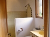 The adjoining full bath in the den/3rd bedroom