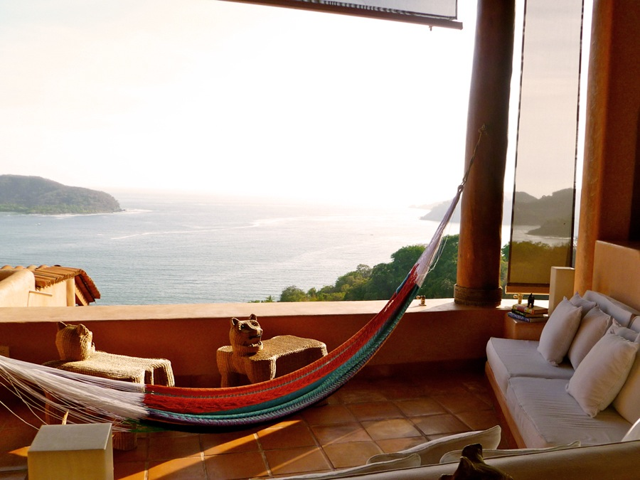Hammock floats in the breeze overlooking Zihuatanejo Bay